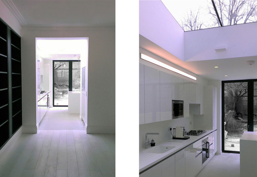 Modern white kitchen in very minimal style with glazed roof. Dean, London.