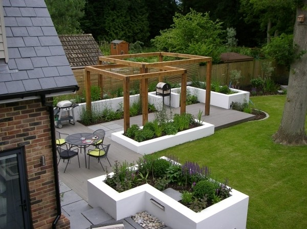 Spacious garden design with concrete and wooden paving by James, landscape designer on Design for Me