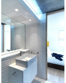 En suite bathroom with square sink by Dinah, architect